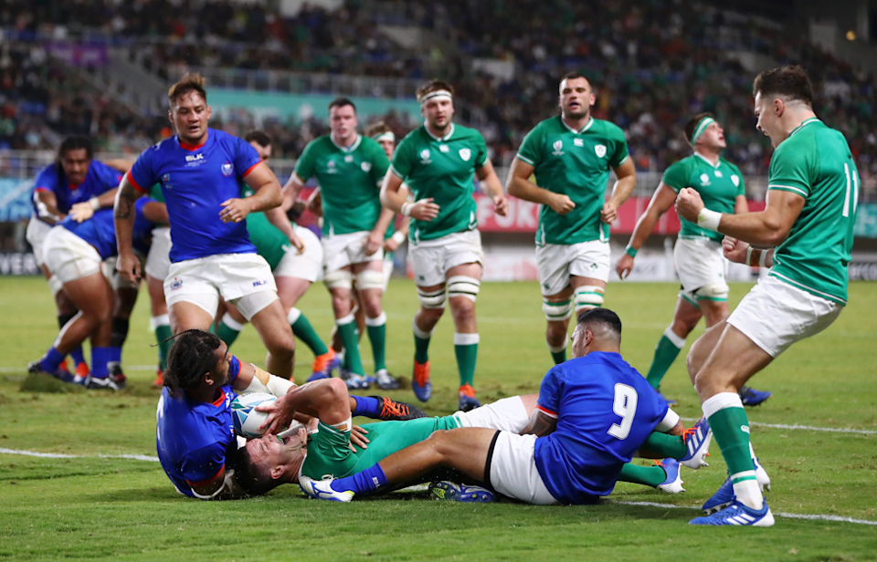 """The pain and the glory...The aftermath of a daring lunge for the line sees Johnny Sexton lying prone on the ground after scoring Ireland's fourth try in a 47 - 5 win. Photographer Michael Steele (Getty Images) says: """"This was shot on a 70-200mm lens which was perfect to show Jonny Sexton of Ireland celebrating after scoring his second try of the game."""""""