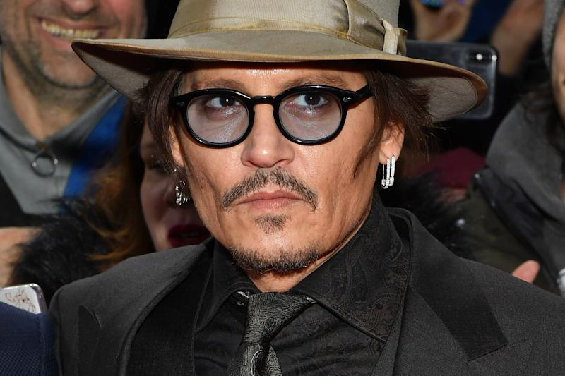 """BERLIN, GERMANY - FEBRUARY 21: Johnny Depp poses at the """"Minamata"""" premiere during the 70th Berlinale International Film Festival Berlin at Friedrichstadt-Palast on February 21, 2020 in Berlin, Germany. (Photo by Stephane Cardinale - Corbis/Corbis via Getty Images)"""