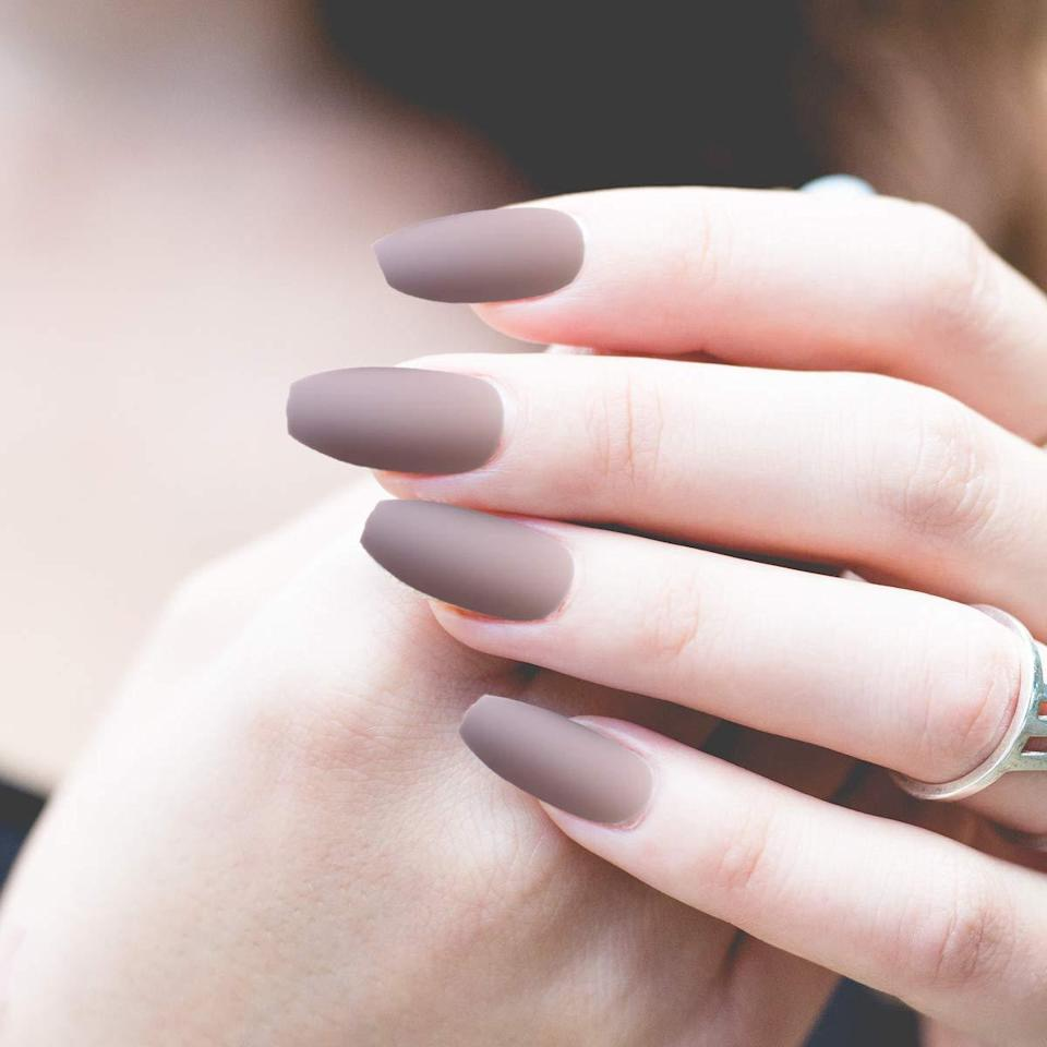 "<p>For a dose of understated glam, look no further than Socu's Matte Press-On Nails, which are offered in a variety of muted gray, brown, burgundy, pink, purple, and black shades. Each set comes with a whopping 72 nails in three different colors, as well as three sheets of adhesive nail tabs and a small nail file, so you truly get your money's worth. Since they naturally come in shorter lengths, these fake nails are ideal for people who want to cut down on the time they usually spend on filing and shaping. Consider them a one-and-done sort of situation.</p> <p><strong>$10</strong> (<a href=""https://www.amazon.com/Packs-Coffin-Matte-Press-Nails/dp/B089SR1QYG?th=1"" rel=""nofollow noopener"" target=""_blank"" data-ylk=""slk:Shop Now"" class=""link rapid-noclick-resp"">Shop Now</a>)</p>"