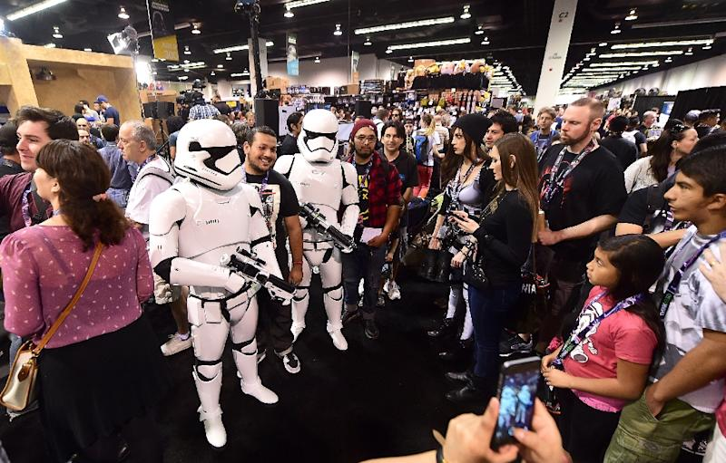 Storm troopers pose for photos during the opening day of the 25th Star Wars Convention on April 16, 2015 in Anaheim, California (AFP Photo/Frederic J. Brown)