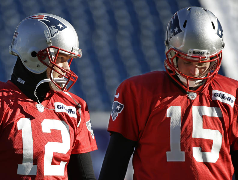 New England Patriots quarterbacks Tom Brady (12) and Ryan Mallett talk as they walk across the field during a stretching and drills session before practice begins at the NFL football team's facility in Foxborough, Mass., Wednesday, Dec. 18, 2013. The Patriots play the Baltimore Ravens Sunday in Maryland. (AP Photo/Stephan Savoia)