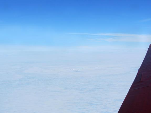 A possible meteorite impact site on the King Baudouin Ice Shelf, seen here from a plane, is more than 1 mile (2 kilometers) wide.