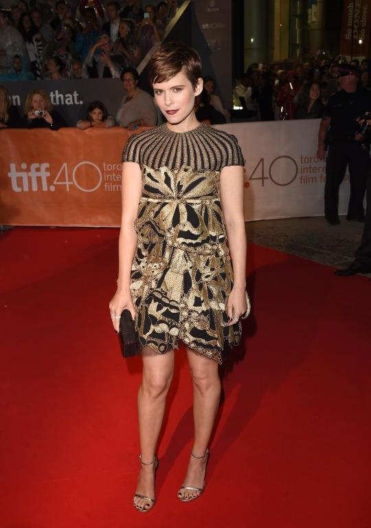 "<p>Kate Mara's cute pixie was offset by her Valentino mini dress with gold brocade and sheer black, giving the actress a darker feel at the premiere of ""The Martian.""</p>"