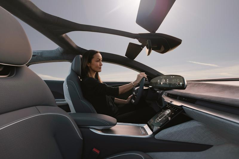 A woman uses touchscreen inside Lucid Air