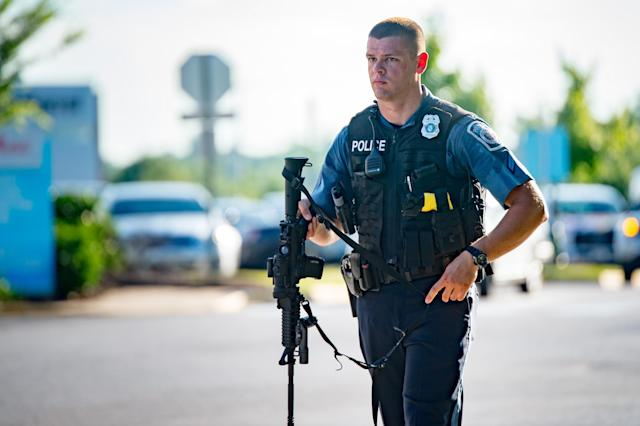 <p>A police official works the scene of a shooting at the Capital Gazette newspaper building in Annapolis, Md., on Thursday, June 28, 2018. (Photo: Michael Jordan via ZUMA Wire) </p>