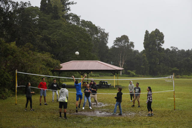 Students play volleyball at the Volcano School of Arts and Sciences in Volcano, Hawaii, Thursday, May 10, 2018. The village is located on the border of Hawaii Volcanoes National Park, just a few miles east of Kilauea's summit crater. (AP Photo/Jae C. Hong)