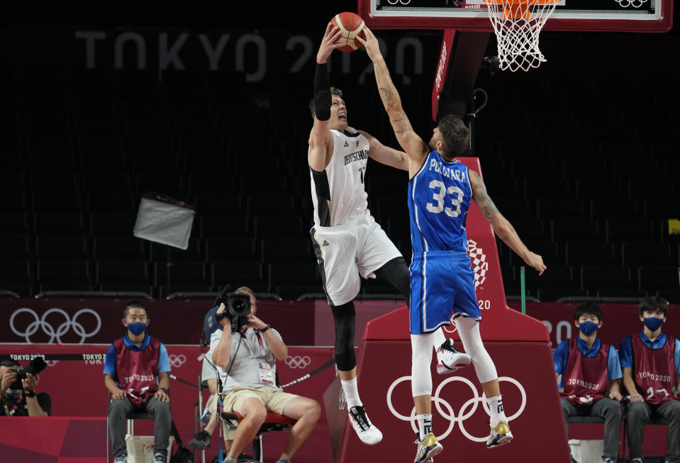 Italy's Achille Polonara, right, and Germany's Moritz Wagner fight a rebound during men's basketball preliminary round game at the 2020 Summer Olympics, Sunday, July 25, 2021, in Saitama, Japan. (AP Photo/Eric Gay)