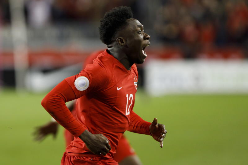 Canada midfielder Alphonso Davies celebrates a goal against the United States during the second half of a CONCACAF Nations League soccer match Tuesday, Oct. 15, 2019, in Toronto. (Cole Burston/The Canadian Press via AP)