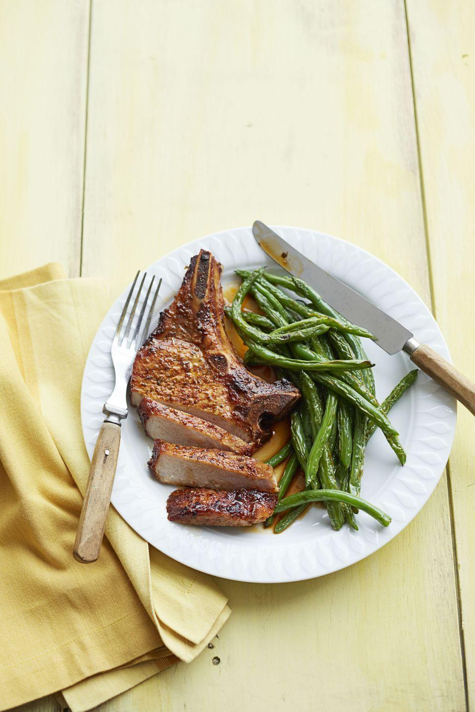 "<p>If you're not using your broiler setting, you're missing out. Thanks to the high heat, these chops cook up in minutes.</p><p><a href=""https://www.goodhousekeeping.com/food-recipes/a15691/new-orleans-pork-charred-beans-recipe-ghk0214/"" rel=""nofollow noopener"" target=""_blank"" data-ylk=""slk:Get the recipe for New Orleans Pork and Charred Beans »"" class=""link rapid-noclick-resp""><em>Get the recipe for New Orleans Pork and Charred Beans »</em></a></p>"