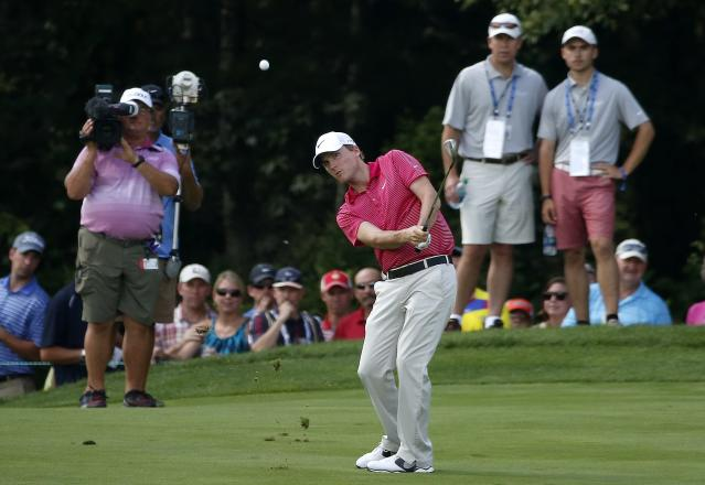 Russell Henley hits his approach shot from the second fairway during the final round of the Deutsche Bank Championship golf tournament in Norton, Mass., Monday, Sept. 1, 2014. (AP Photo/Michael Dwyer)