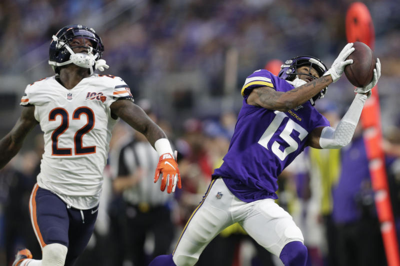 Minnesota Vikings wide receiver Alexander Hollins (15) catches a pass ahead of Chicago Bears defensive back Kevin Toliver (22) during the second half of an NFL football game, Sunday, Dec. 29, 2019, in Minneapolis. (AP Photo/Andy Clayton-King)