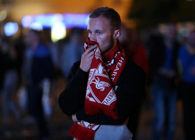 Soccer Football - Champions League Final - Real Madrid v Liverpool - Kiev, Ukraine - May 26, 2018 Liverpool fan looks dejected after watching the match on a television screen outside in Kiev REUTERS/Viacheslav Ratynskyi