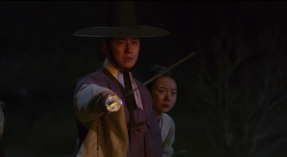 "Crown Prince Chang and Seo Bi battle zombies in ""Kingdom""."