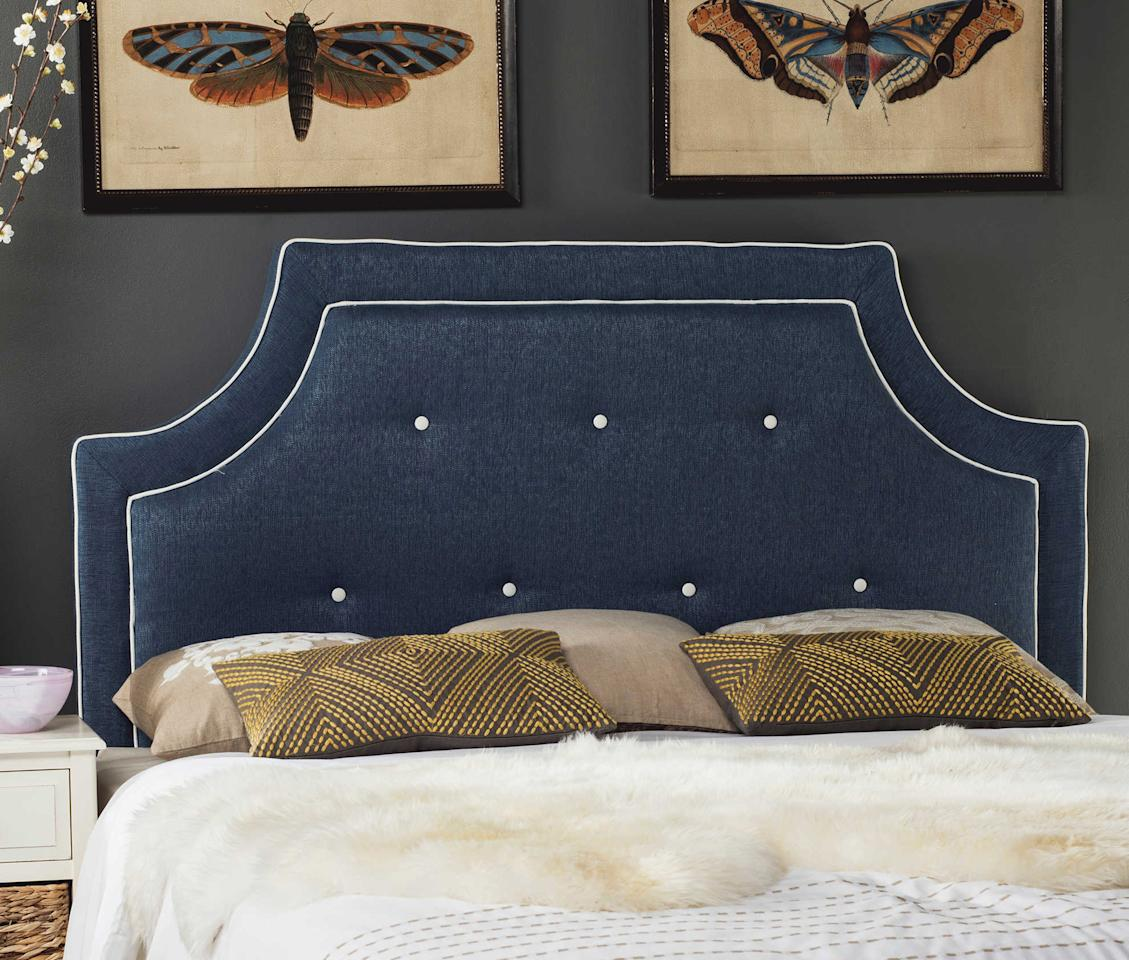 """<p>This upholstered headboard with notched corners only looks expensive. We love this headboard paired with classic white bedding.</p>  <p><b>BUY IT: </b>starting at<b> </b>$171; <a rel=""""nofollow"""" href=""""https://www.bedbathandbeyond.com/store/product/safavieh-tallulah-headboard-in-denim-blue-white/3295190"""">bedbathandbeyond.com</a></p>"""