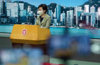 Hong Kong Chief Executive Carrie Lam listens to reporters' questions during a press conference in Hong Kong, Tuesday, Sept. 15, 2020. Lam said Tuesday that the government had not received any information from Taiwan authorities regarding the reported detention of five Hong Kongers who allegedly fled to the self-governing island by boat. (AP Photo/Vincent Yu)