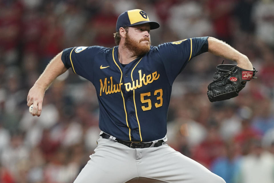 Milwaukee Brewers starting pitcher Brandon Woodruff (53) works against the Atlanta Braves during the seventh inning of Game 4 of a baseball National League Division Series, Tuesday, Oct. 12, 2021, in Atlanta. (AP Photo/Brynn Anderson)