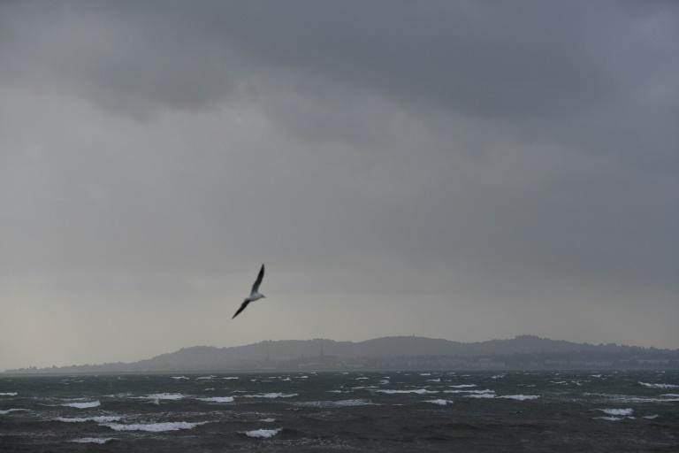 Dark clouds gathered over the Irish Sea and Dublin as Ireland braced for the passing of the storm Ophelia that left three dead and hundreds of thousands of homes without power