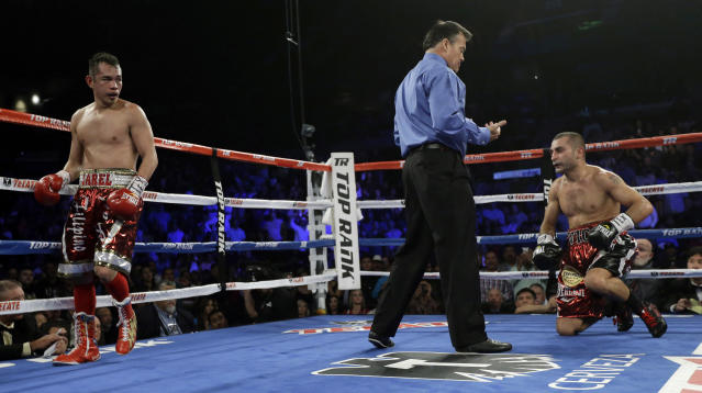 Nonito Donaire, left, steps back after knocking Vic Darchinyan to the mat during round 9 of their featherweight rematch, Saturday, Nov. 9, 2013, in Corpus Christi, Texas. (AP Photo/Eric Gay)