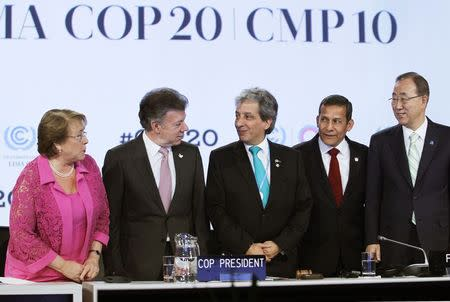 (L to R) Chile's President Michelle Bachelet, Colombia's President Juan Manuel Santos, Peru's Environment Minister Manuel Pulgar Vidal, Peru's President Ollanta Humala and United Nations Secretary-General Ban Ki-moon pose for the media during the High Level Segment of the U.N. Climate Change Conference COP 20 in Lima, December 10, 2014. REUTERS/Enrique Castro-Mendivil