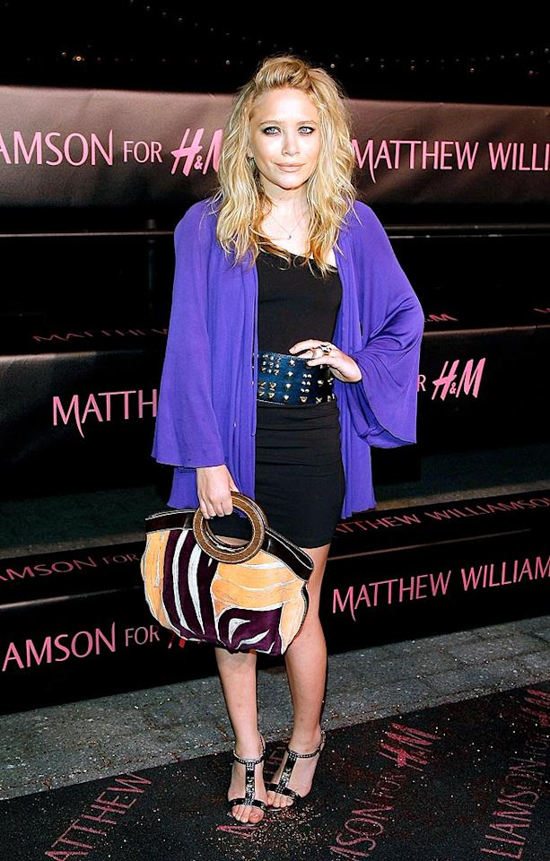 """Mary-Kate Olsen's pose was awkward, but the combination of her asymmetrical Matthew Williamson LBD, loose-fitting purple jacket, studded belt, and leather handbag worked wonders. Jemal Countess/<a href=""""http://www.wireimage.com"""" target=""""new"""">WireImage.com</a> - April 28, 2009"""