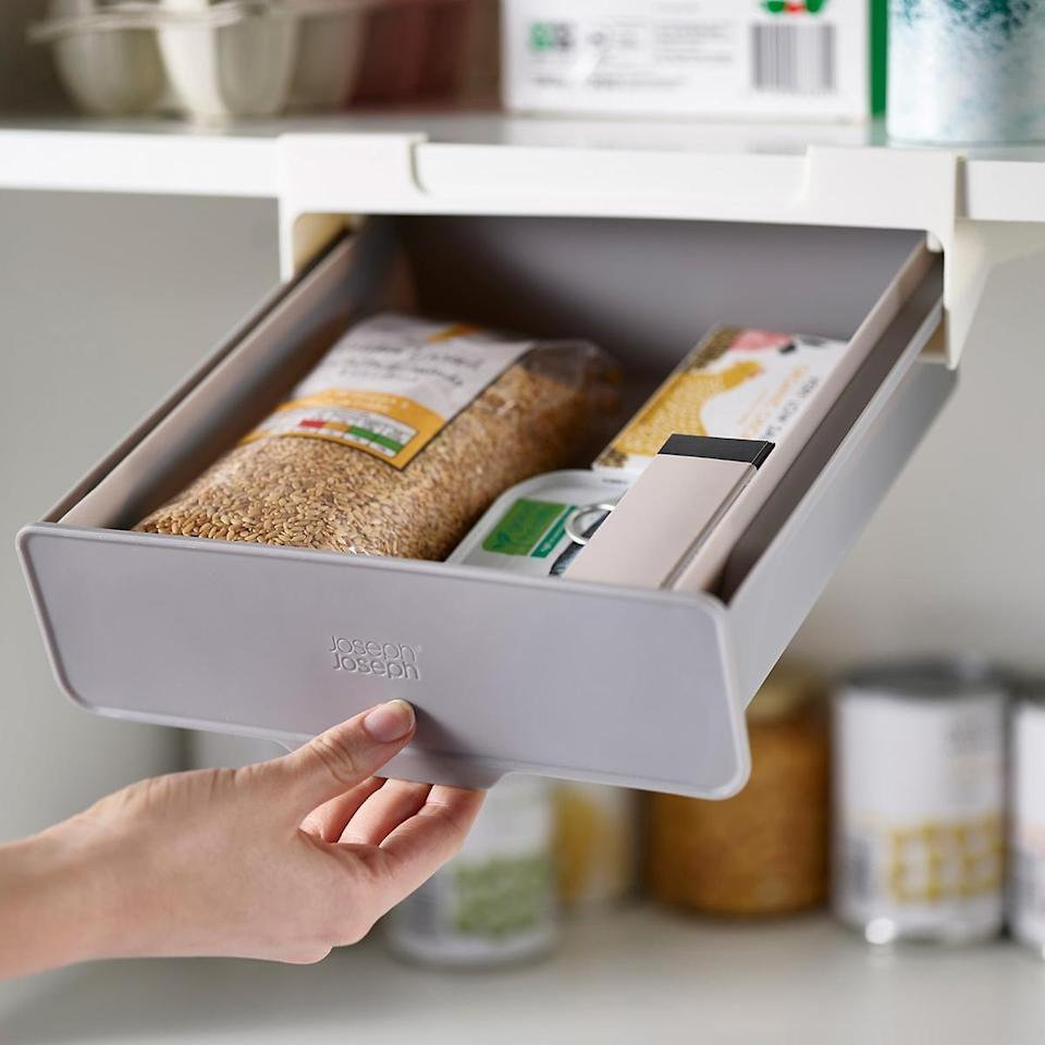 <p>Add some extra storage space to your cabinets with the <span>Joseph Joseph CupboardStore Under Shelf Drawer</span> ($15). You can store smaller items like snacks and bags.</p>