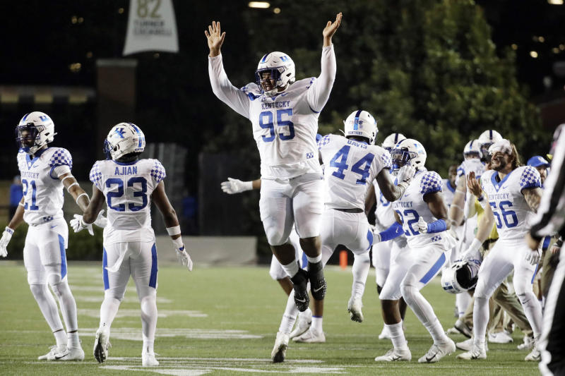 Kentucky nose tackle Quinton Bohanna (95) celebrates after his team stopped a Vanderbilt drive in the fourth quarter of an NCAA college football game Saturday, Nov. 16, 2019, in Nashville, Tenn. (AP Photo/Mark Humphrey)