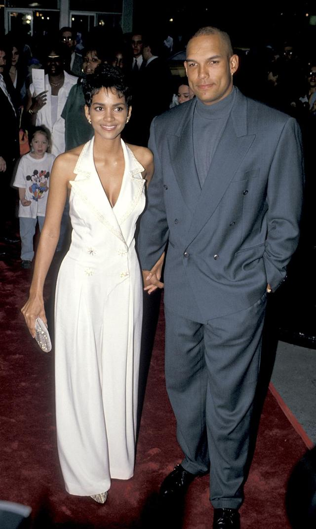 "<p>Berry attends the New York premiere with then-husband and MLB star David Justice. Her character, Sharon Stone, in the live-action version of the popular cartoon series was <a href=""http://screencrush.com/see-the-cast-of-the-flintstones-then-and-now/"" rel=""nofollow noopener"" target=""_blank"" data-ylk=""slk:originally created"" class=""link rapid-noclick-resp"">originally created</a> for actress Sharon Stone (hence the name) but the <em>Basic Instinct</em> star had a scheduling conflict and the role went to Berry.<br> (Photo: Getty Images) </p>"