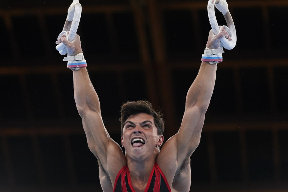The Russian Olympic Committee's Artur Dalaloyan performs on the rings during the men's artistic gymnastic qualifications at the 2020 Summer Olympics, Saturday, July 24, 2021, in Tokyo. (AP Photo/Gregory Bull)