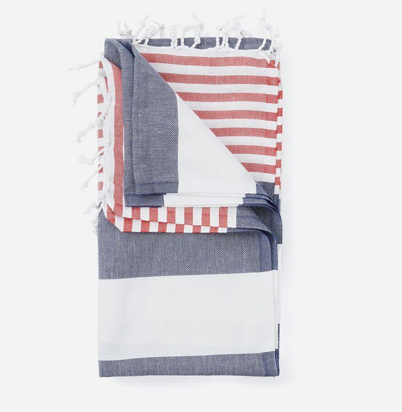 """<p><strong>Turkish Towels</strong></p><p>huckberry.com</p><p><strong>$18.98</strong></p><p><a href=""""https://go.redirectingat.com?id=74968X1596630&url=https%3A%2F%2Fhuckberry.com%2Fstore%2Fturkish-towels%2Fcategory%2Fp%2F53684-mediterranean-turkish-towel&sref=https%3A%2F%2Fwww.esquire.com%2Fstyle%2Fmens-fashion%2Fg32631767%2Fsummer-mens-fashion-memorial-day-sale%2F"""" rel=""""nofollow noopener"""" target=""""_blank"""" data-ylk=""""slk:Buy"""" class=""""link rapid-noclick-resp"""">Buy</a></p><p>A towel that's comfortable holding its own next to your fanciest couch throws. </p>"""