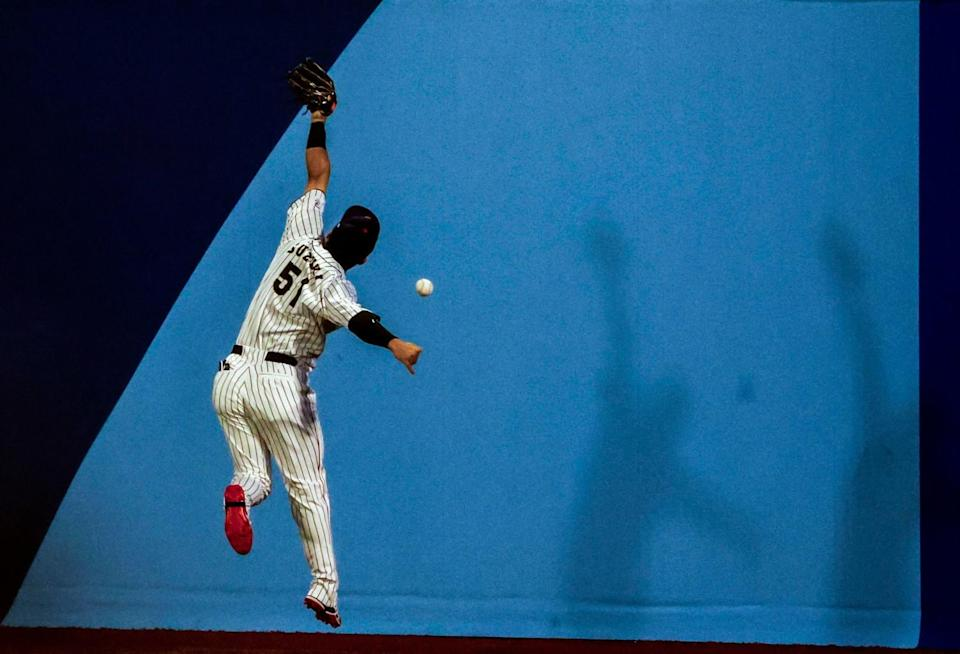 Team Japan outfielder Seiya Suzuki (51) can't catch up to double hit by Team South Korea outfielder Jung Hoo Lee (51)