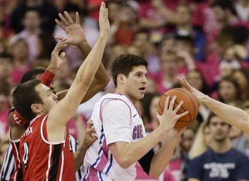Creighton's Doug McDermott, center, is defended by Bradley's Jake Eastman, left front, and Tyshon Pickett, left rear, and Will Egolf, right, in the first half of an NCAA college basketball game in Omaha, Neb., Saturday, Feb. 2, 2013. (AP Photo/Nati Harnik)