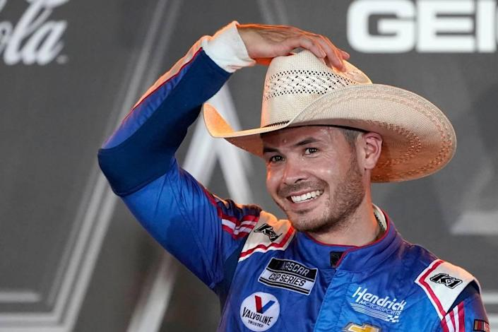 Kyle Larson puts on a cowboy hat as he celebrates in Victory Lane after winning the NASCAR Cup Series All-Star auto race at Texas Motor Speedway in Fort Worth, Texas, Sunday, June 13, 2021. (AP Photo/Tony Gutierrez)