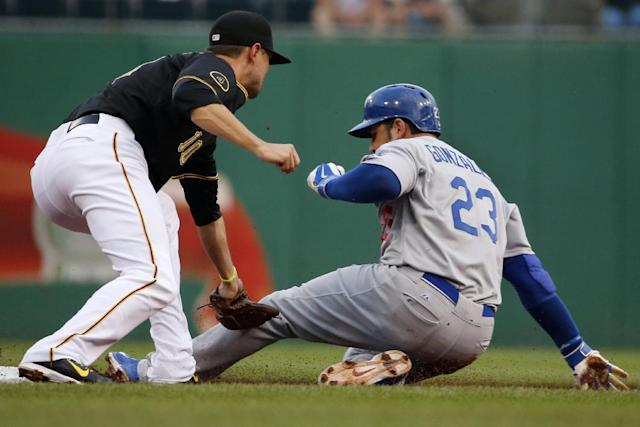 Los Angeles Dodgers' Adrian Gonzalez (23) steals second ahead of the tag by Pittsburgh Pirates shortstop Jordy Mercer (10) during the first inning of a baseball game in Pittsburgh Monday, July 21, 2014. (AP Photo/Gene J. Puskar)