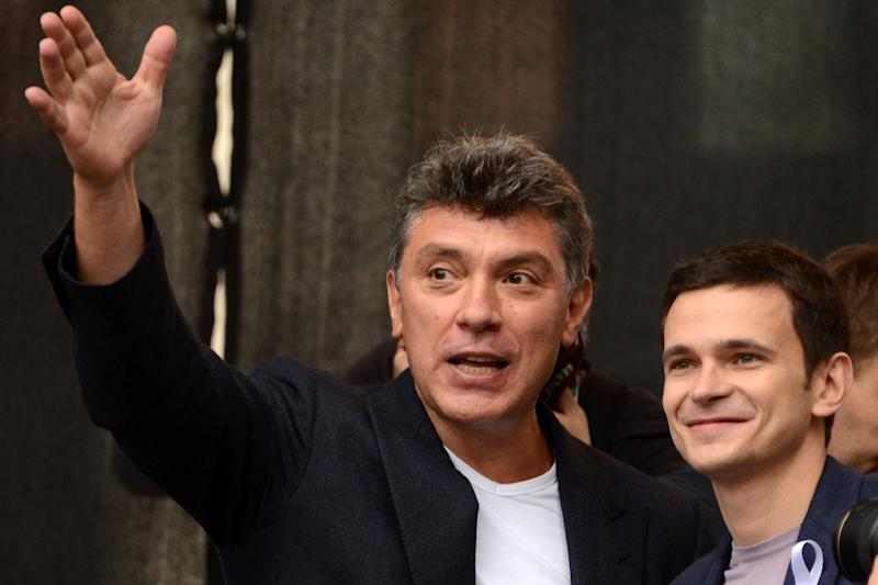 Russian activist Boris Nemtsov (left) and Ilya Yashin take part in a 2012 opposition rally in Moscow (AFP Photo/Kirill Kudryavtsev)