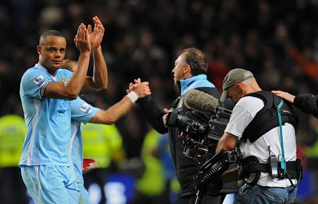"Manchester City's Belgian footballer Vincent Kompany (L) applauds the crowd after beating Manchester United 1-0 during their English Premier League football match at The Etihad stadium in Manchester, north-west England on April 30, 2012. AFP PHOTO/ANDREW YATES RESTRICTED TO EDITORIAL USE. No use with unauthorized audio, video, data, fixture lists, club/league logos or ""live"" services. Online in-match use limited to 45 images, no video emulation. No use in betting, games or single club/league/player publications.ANDREW YATES/AFP/GettyImages"