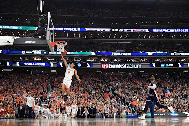 Kihei Clark #0 of the Virginia Cavaliers shoots against Malik Dunbar #4 of the Auburn Tigers on a breakaway during the second half of the semifinal game in the NCAA Men's Final Four at U.S. Bank Stadium on April 06, 2019 in Minneapolis, Minnesota. (Photo by Jamie Schwaberow/NCAA Photos via Getty Images)