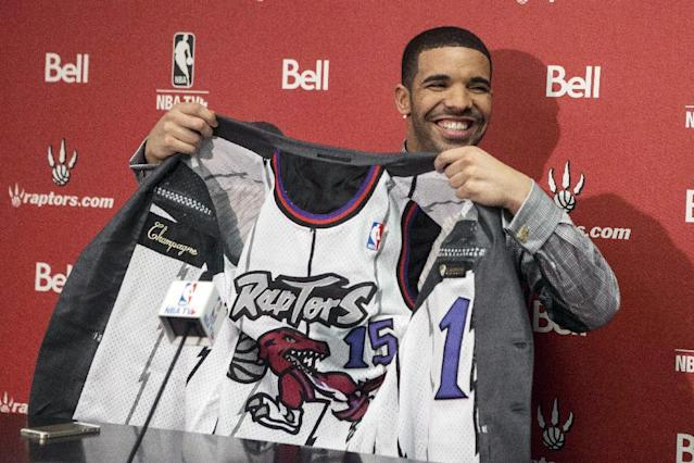 Hip Hop Sta Drake shows off the lining of his suit during a press conference before the Toronto Raptors' NBA game against Brooklyn Nets in Toronto on Saturday Jan. 11 , 2014.(AP Photo/The Canadian Press, Chris Young)