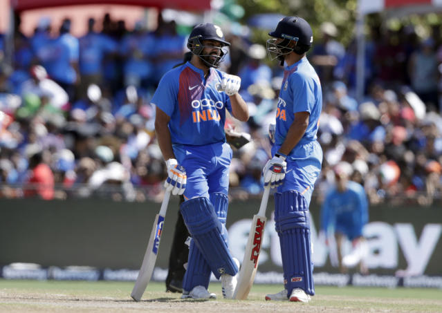 India's Rohit Sharma, left, and Shikhar Dhawan, right, talk during the second Twenty20 international cricket match against the West Indies, Sunday, Aug. 4, 2019, in Lauderhill, Fla. (AP Photo/Lynne Sladky)