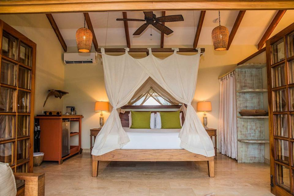 A guest room with a canopy bed at Casa Chameleon Mal Pais, voted one of the best hotels in the world
