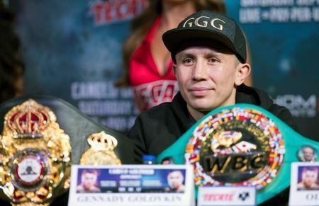 FILE PHOTO: WBC/WBA/IBF middleweight champion Gennady Golovkin of Kazakhstan sits behind his belts during a news conference at MGM Grand hotel and casino in Las Vegas, Nevada, U.S. September 13, 2017. REUTERS/Las Vegas Sun/Steve Marcus
