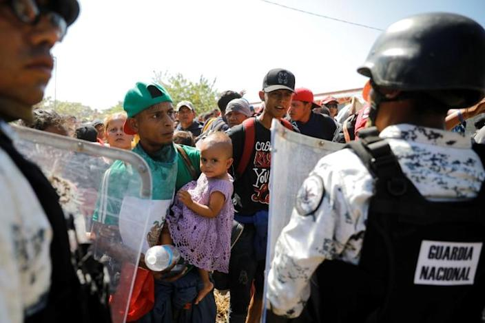 Large migrant caravan prepares to enter Mexico from Guatemala