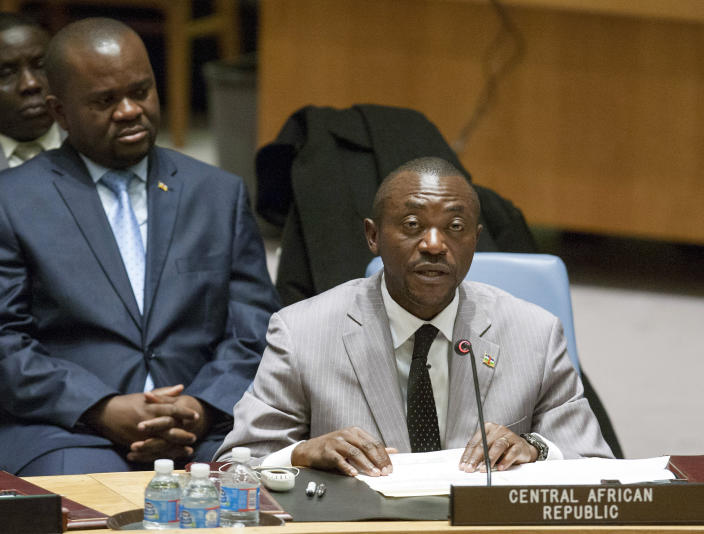 In this photo provided by the United Nations, Charles-Armel Doubane, the Permanent Representative of the Central African Republic to the UN, right, addresses the United Nations Security Council at U.N. Headquarters, Thursday, Dec. 5, 2013. During the session, the U.N. Security Council authorized increased military action by France and African troops in the Central African Republican to try to end near-anarchy amid an upsurge in Muslim-Christian violence, killings, torture and rapes. The man at left is unidentified. (AP Photo/The United Nations, Amanda Voisard)