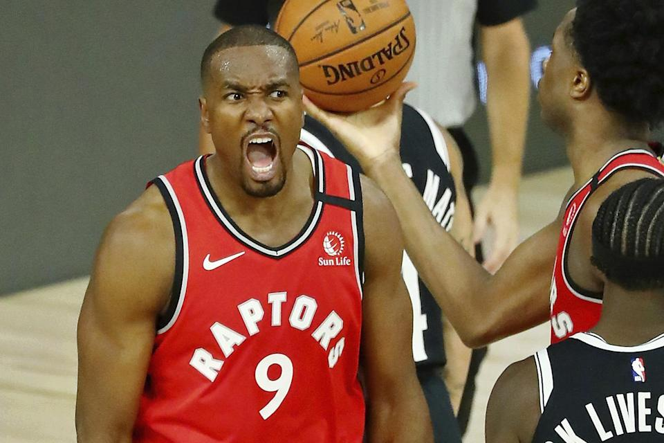 Toronto Raptors center Serge Ibaka (9) celebrates after making a basket against the Brooklyn Nets during the second half in Game 3 of an NBA basketball first-round playoff series, Friday, Aug. 21, 2020, in Lake Buena Vista, Fla. (Kim Klement/Pool Photo via AP)