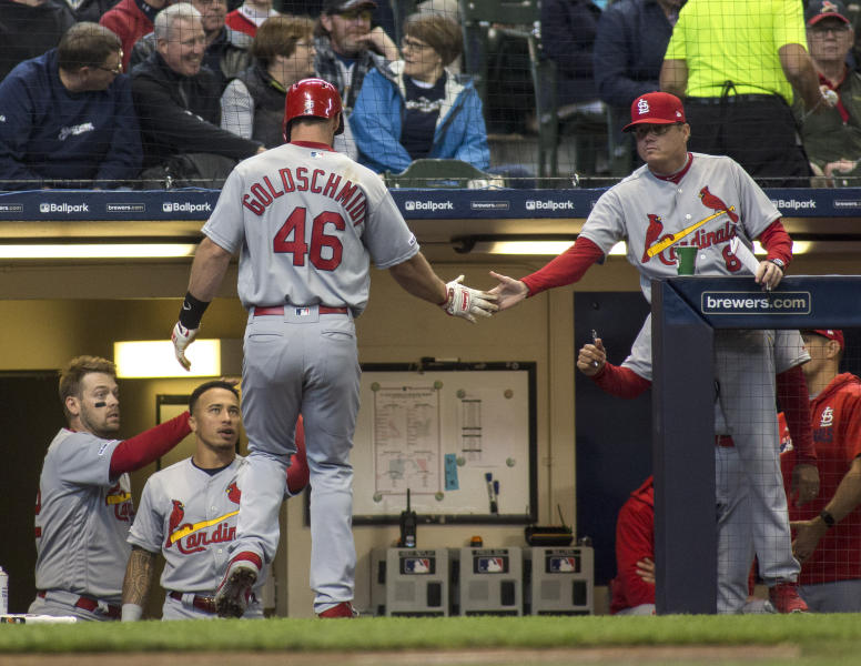 St. Louis Cardinals' Paul Goldschmidt is congratulated by the bench after scoring off a RBI single against the Milwaukee Brewers by Paul DeJong during the third inning of a baseball game Wednesday, April 17, 2019, in Milwaukee. (AP Photo/Darren Hauck)