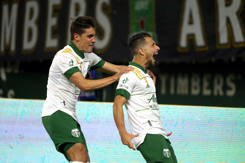 Portland Timbers midfielder Sebastian Blanco, right, celebrates his goal in extra time to give the Timbers a 2-2 draw with the Colorado Rapids durin an MLS soccer match Wednesday, Sept. 15, 2021, in Portland, Ore. (Sean Meagher/The Oregonian via AP)