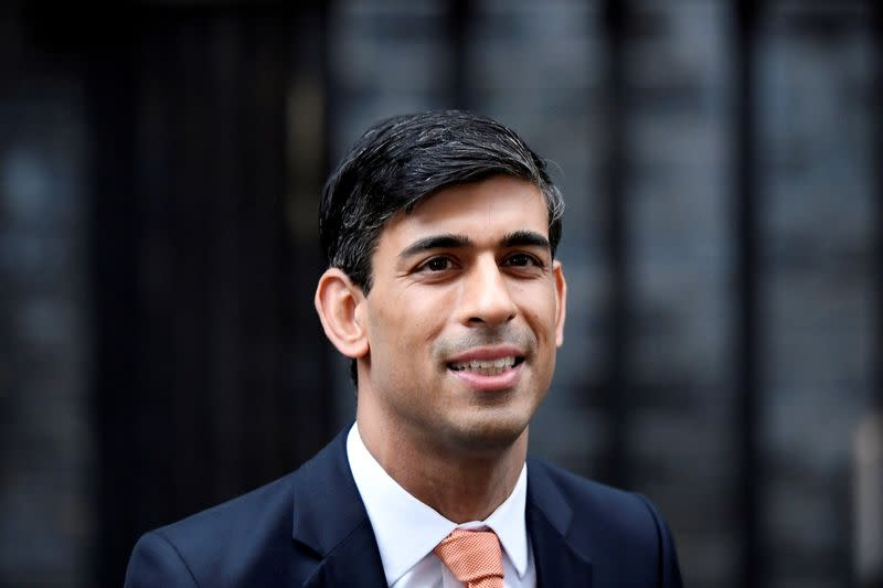 FILE PHOTO: FILE PHOTO: Newly appointed Britain's Chancellor of the Exchequer Rishi Sunak leaves Downing Street in London