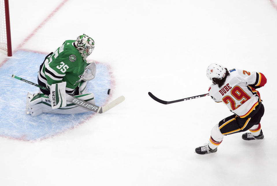Calgary Flames' Dillon Dube (29) is stopped by Dallas Stars goalie Anton Khudobin (35)] during the first period in Game 1 of an NHL hockey Stanley Cup first-round playoff series, Tuesday, Aug. 11, 2020, in Edmonton, Alberta. (Jason Franson/The Canadian Press via AP)