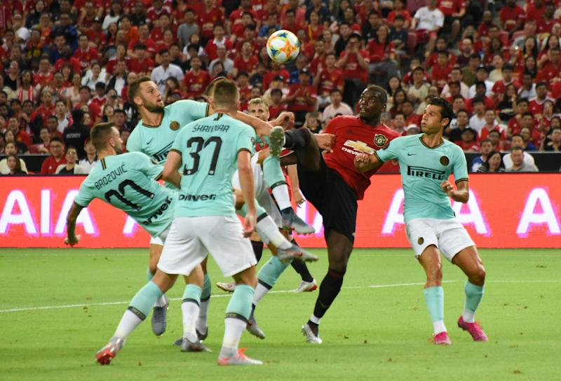 Manchester United's Paul Pogba (red jersey) fights for the ball with a few Inter Milan players during their International Champions Cup match at the National Stadium. (PHOTO: Zainal Yahya/Yahoo News Singapore)