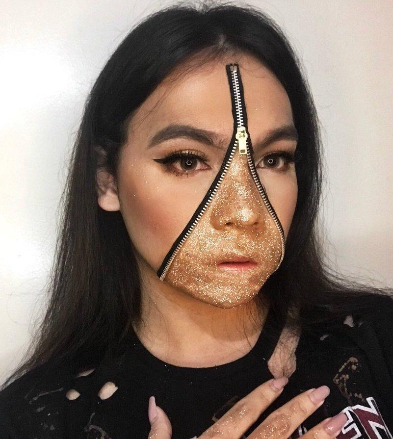 <p>Many of the bloggers and make-up artists demonstrating how to create the look finished the aesthetic with matching body glitter on their hands and décolletage. <em>[Photo: Twitter]</em> </p>