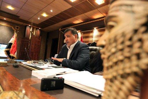 Iraqi Tourism and Archaeology Minister Liwaa Smaisim speaks during an interview with AFP at his office in Baghdad